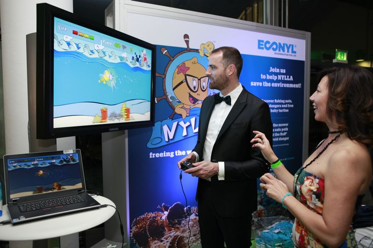 """ECONYL® at the GreenTec Awards 2014 in Munich. The brand developed a video-game """"Nylla"""" to inspire people and raise awareness about the problem of ghost fishing nets. Through the ECONYL® Regeneration System, waste can be regenerated into new ECONYL® fibre to give life to new products. #ethical #fashion and #design"""