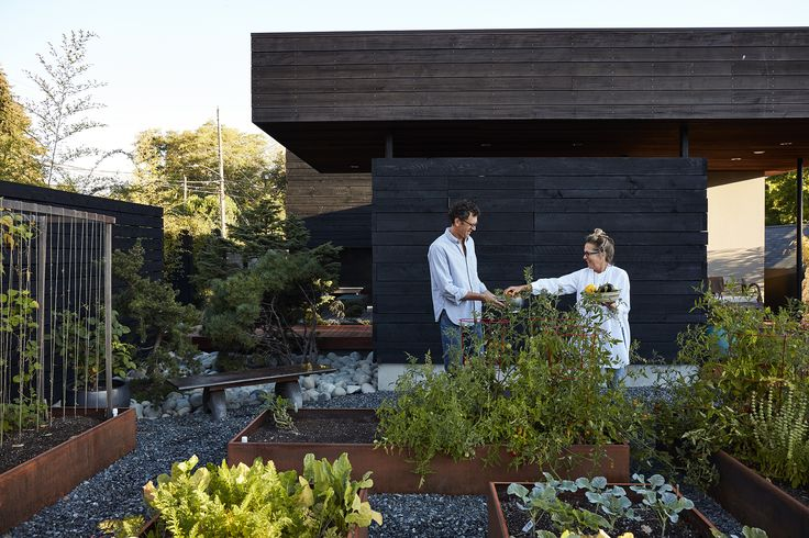 Cor-Ten steel planters host a bounty of fresh herbs, fruits, and vegetables.