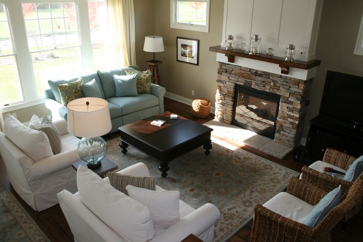 Our Craftsman Style Beach House Gathering Room  McCreary Modern slipcovered chairs and sleeper sofa, Paula Deen coffee table, Pottery Barn table and sculpture stand lamp