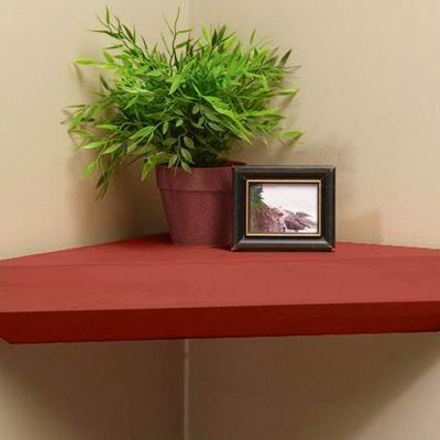 Install wood corner shelves to take advantage of untapped space. Use a pair to raise cordless speakers off the ground.