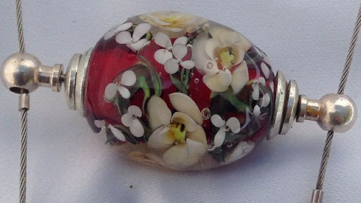 A personal favourite. Floral lamp work bead by Vicki Beldan.