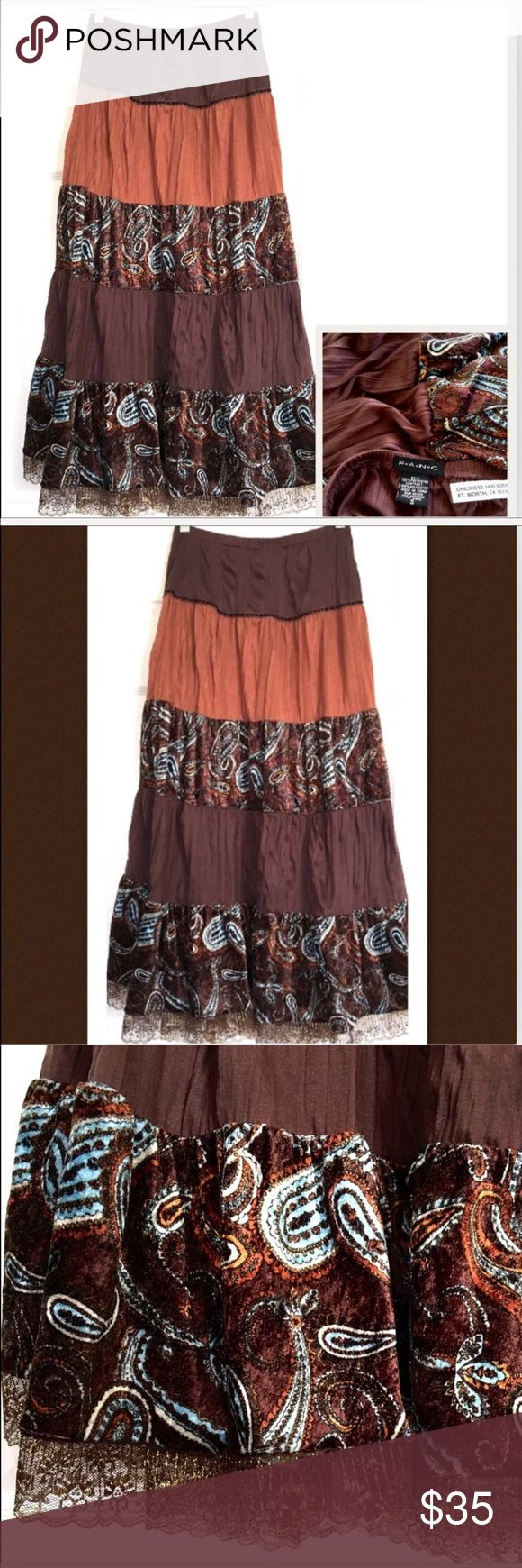 "rare fang Vintage boho gypsy skirt XS maxi FANG gypsy skirt, in gorgeous chocolate brown and copper tones, with layers of velvet print, and metallic lace trim. This skirt has clearly been taken in at the waist, so I am listing it as an XS, please see photos of the alteration. This beautiful skirt has a life of its own, it is worn, and shows minor signs of a life well lived, but is still absolutely gorgeous, and worthy of a new home. XS waist = 28"" thru 30"" comfortably, length = 34"", buyer…"