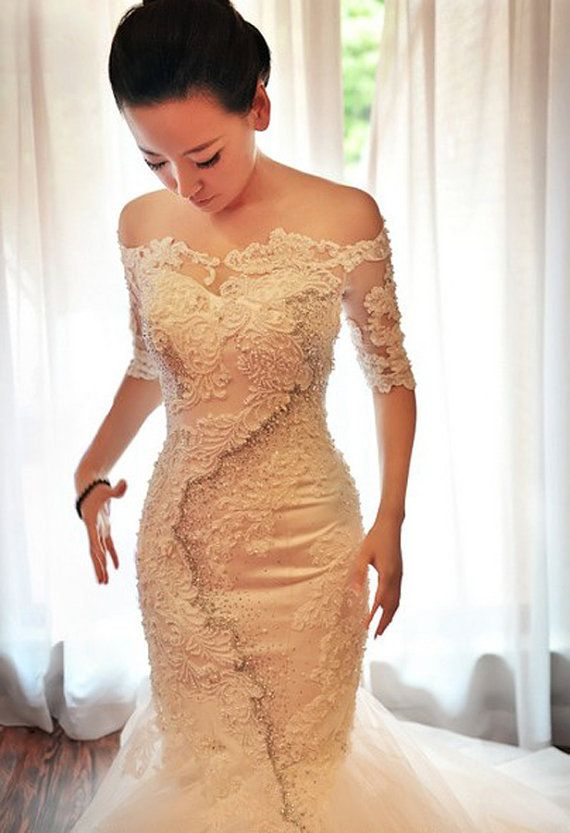Original designed,Luxury Fishtail Off-the-shoulder Wedding Dress,which is really amazing with lace applique and beaded embroidery,also with the half sleeves and mermaid design,the dress appears so charming for brides on outdoor weddings on summer and fall season.