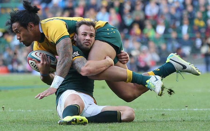 Australia's Joe Tomane is brought down by Francois Hougaard