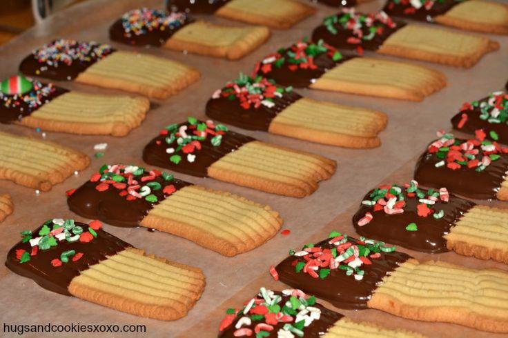 Hands Down…The Best Spritz Cookie Recipe - then the cookies are dipped in Chocoley Chocolate from hugsandcookiesxoxo.com