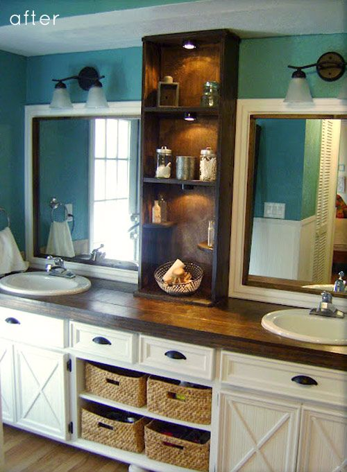 my god; i want this for my bathroom. O_o <3    From Design Sponge:  Omar's DIY bath remodel,  He took the old formica cabinets and raised them added what looks like bun legs.  Opened the bottom center cabinets and made shelves for baskets. Doors are resurfaced.  Mirror is same large mirror with shelf covering the middle and frames to give the look of two separate mirrors.  At $200, Very cool!