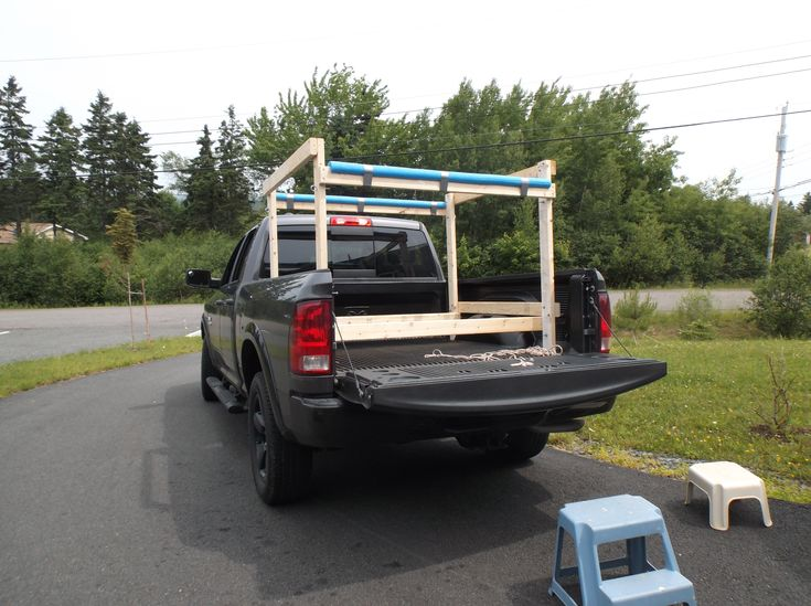 The Rack Fits Into The Bed Of The Truck And Is Tied To The