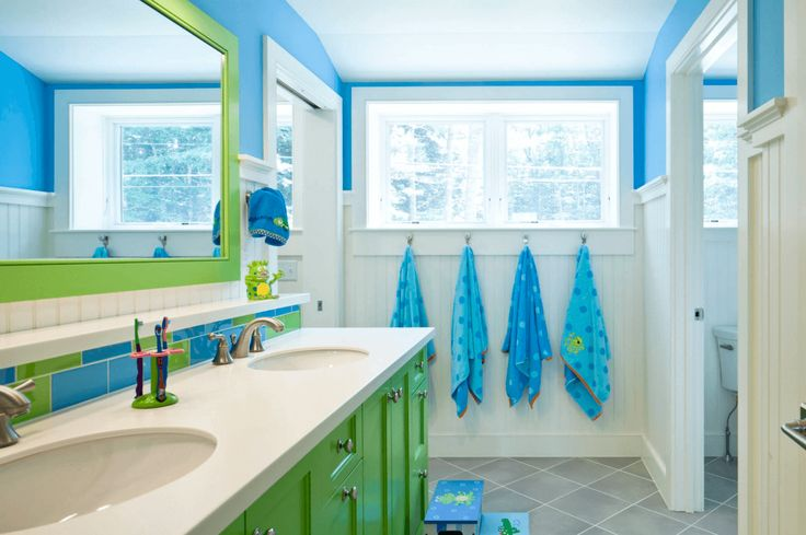 Blue And Green Kids' Bathroom Vibrant colors and whimsical details are perfect for a kids' bathroom.