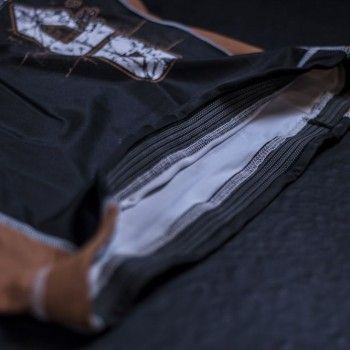 Anti-rise features in the rubberized elastic waistband and long skirt.