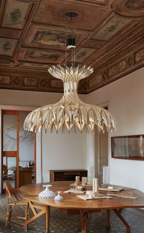 dome180 chandelier by bover making a brilliant emphatic statement above a dining table light