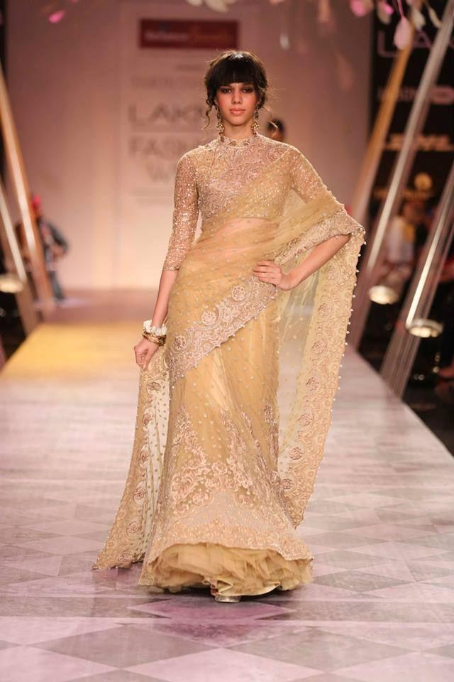 Tarun Tahiliani Lakme Fashion Week Summer 2014 - gold glitter lehnga. See all Fashion Week photos here: http://www.indianweddingsite.com/indian-wedding-photo-gallery/fashion-lakme-fashion-week-summer-resort-2014/