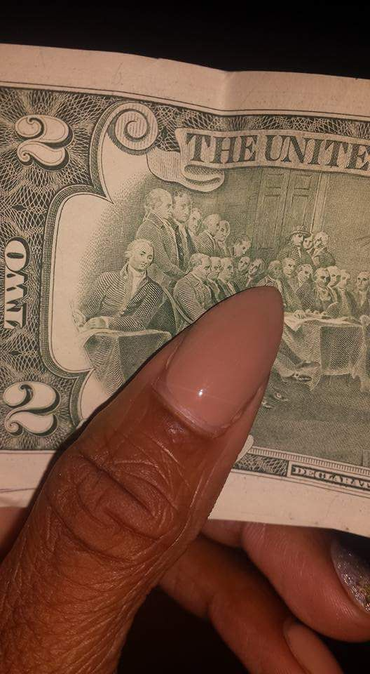 Up close and personal pic of the 2$ bill. John Hanson who was a moor and some say was the first President of the United States.