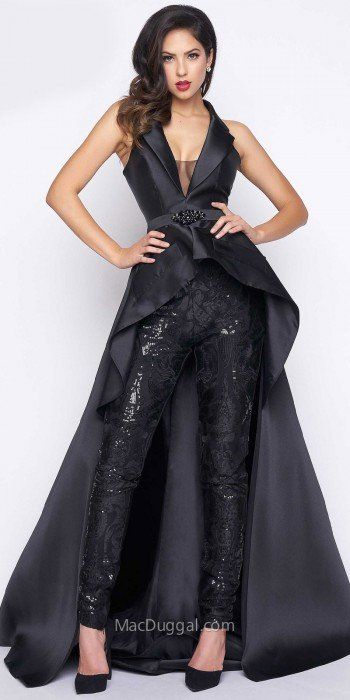 Look like a rockstar and make an impact upon arrival in the stylish Satin Sequin Skinny Leg Overskirt Jumpsuit by Mac Duggal. This striking number features a V-shape tuxedo collar neckline with an illusion mesh panel, a sleeveless bodice and a covered back. This jumpsuit also includes sequin skinny pants, an embellished waistline and a high-low satin over skirt with a dramatic sweep train. #edressme