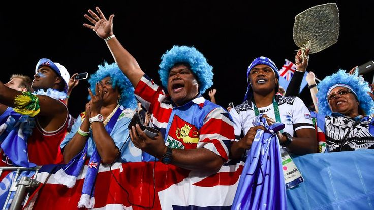 Fiji supporters celebrare following the Men's rugby sevens gold medal match between Fiji and Great Britain.