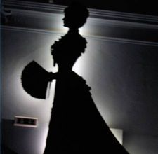 made with an overhead projector! http://www.ehow.com/how_4868314_make-silhouettes-using-overhead-projector.html