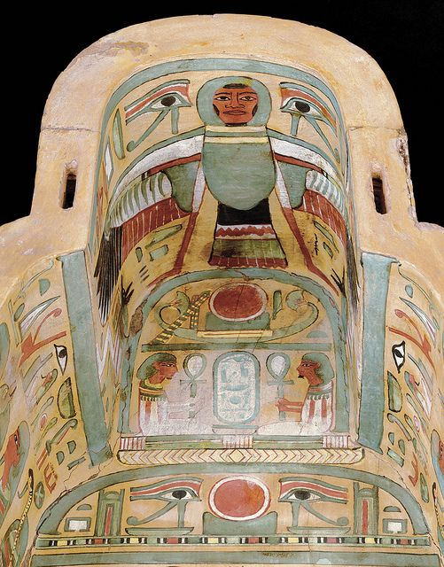 "STAR GATES: Sarcophagus,Paint Sycamore Fig Wood-900–940 BCE.Is it a flying machine? Ahuman-head-bird? labeled ""King who comes forth/ascends from the horizon"",seated jackal deities below the wings,righta female,an Ipt).on both shoulders,""A Royal Offering Formula to Osiris,king of Eternity,the West"". where the head would rest,the sign, solar disk""horizon"". The second from the top reads ""Osiris, king of Eternity"", The next down(solar disk) in the center is flanked by wadjet-eyes and shrines."