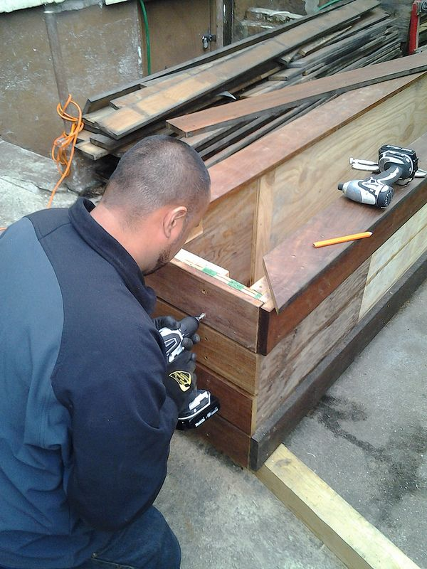 One of New York Plantings' Men Finishing Up Custom Planter Box