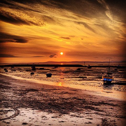 Ryan Parkinson: Moored boats overlooked by Morecambe Bay sunset.Photograph: Ryan Parkinson