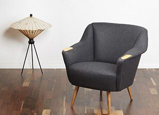 A 50s cocktail chair. Lovely design with curved out armrests and tapered and splayed legs. Very comfortable - great addition to any vintage or modern interior. www.viremo.co.uk