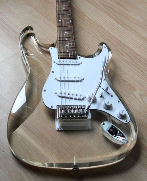 NEW CUSTOM HOT PLAYING ACRYLIC STRAT STYLE ELECTRIC GUITAR - I wonder what kind of tone that would have.