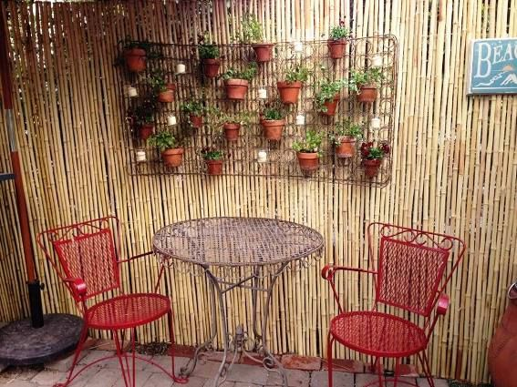 Jill Beniak uses an entire bed spring as a garden art background and wires in flower pots