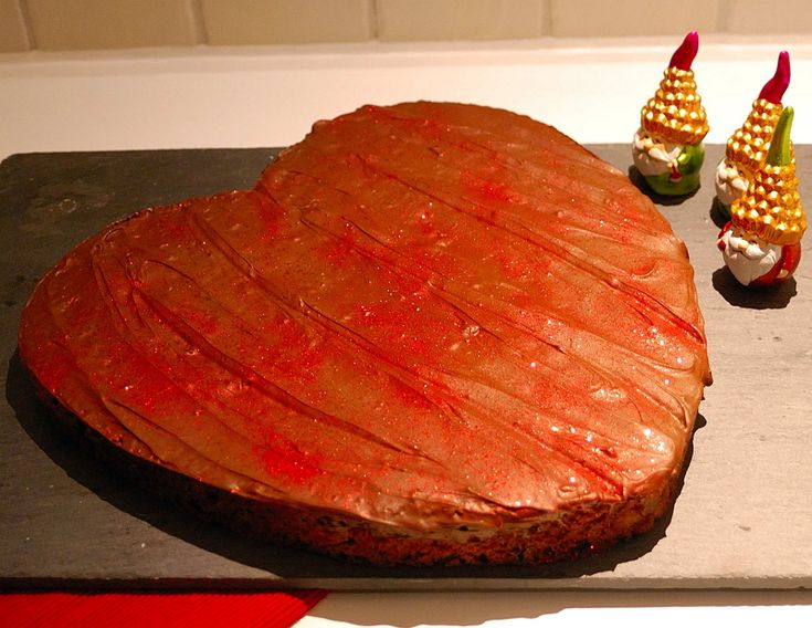 Gingerbread cake with Vanilla filling in shape of a Heart. Decorated with chocolate and red shimmer (can be eaten)