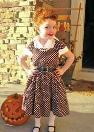Little Girl wearing a Lucille Ball costume