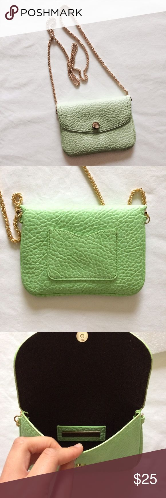 "Green Crossbody Purse Never used. Brand new. Magnetic closure. By brand ""Street Level."" You can buy this brand at Nordstrom. Neon green color with gold chain. Has a pocket on the back which could fit a business card or credit card. Street Level Bags Crossbody Bags"