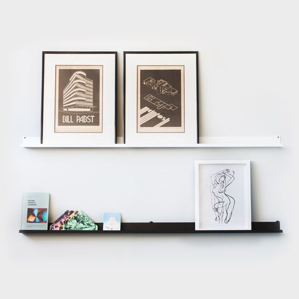 Picture Rail. Display art, post cards or LP's without having to nail into the wall the whole time with this picture rail. Neat.