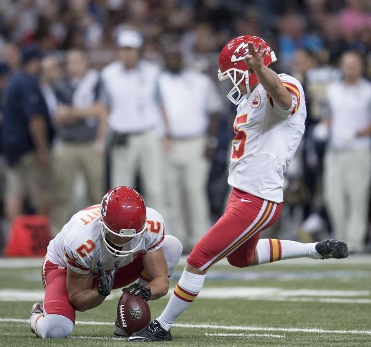 Kansas City Chiefs punter Dustin Colquitt (2) held the ball as Kansas City Chiefs kicker Cairo Santos (5) put it through the uprights in the second quarter during the Kansas City Chiefs and St. Louis Rams football game in the Edward Jones Dome on Thursday, September 3, 2015, in St. Louis, Missouri.