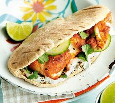 Bursting full of vibrant tandoori spices and served with fresh, crunchy vegetables, these lightly spiced fish pittas make for a tasty outdoor summertime meal. They're quick to cook and delicious to eat. | Tesco