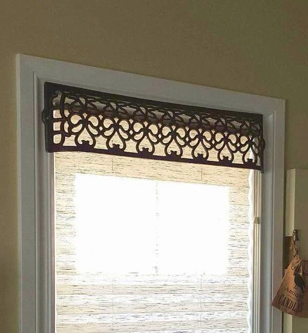This antique cast iron register cover served well as a window valance .