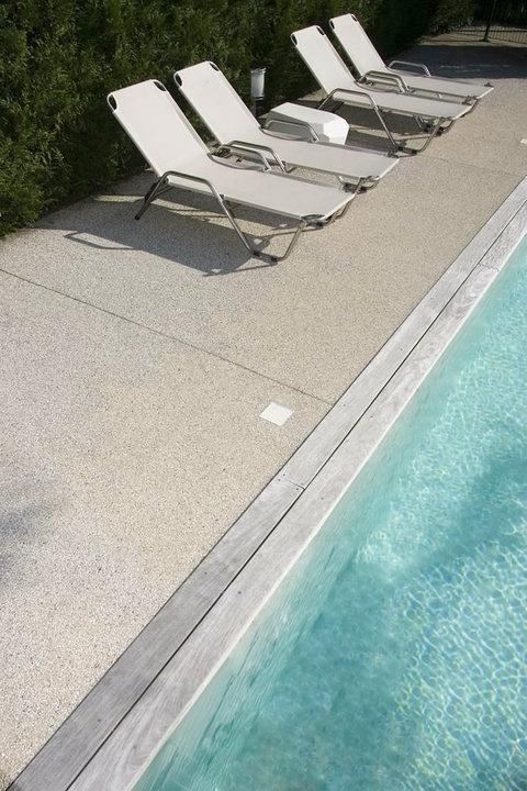 Am nagement d 39 un contour de piscine en articimo stabilis am nagement - Contour de piscine en pierre ...