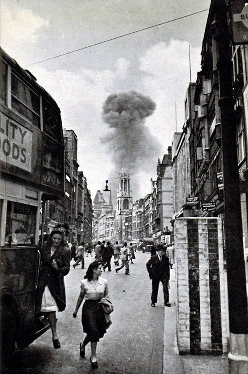 A V-1 flying bomb lands in a street off Drury Lane, London, 1944