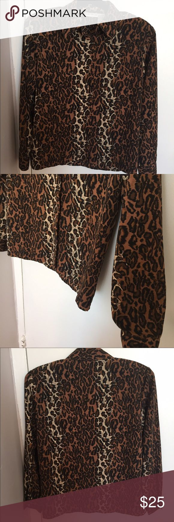 NWOT Animal Print Blouse Size 8 Beautiful animal print blouse.m, very light weight, removable shoulder pads inside, chest is 40 all around, length is 24 inches, polyester. Never worn! Martinique Tops Blouses