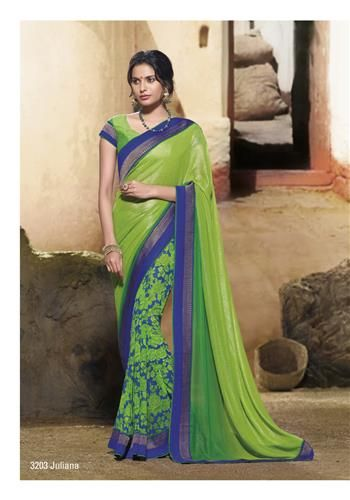Glossy look to all pretty women there...with fantastic flowery print on blue color saree & parrot green shining pallav.