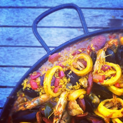 a juicy seafood paella cooking away at the wild rabbit'd paella feast,  pic from a fellow feaster...hat from colourmehattie.blogspot.com.au