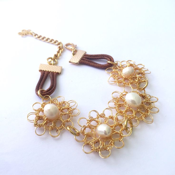 A personal favorite from my Etsy shop https://www.etsy.com/listing/519483860/gold-filled-wire-woven-bracelet-with