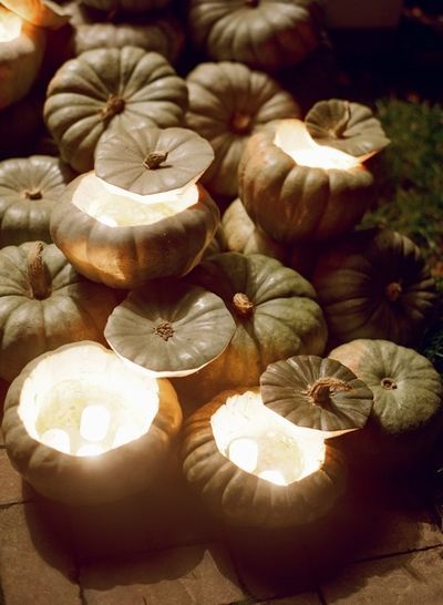 Okay, is this cheesy, or cool? I kind of love this idea of using baby pumpkins as votive holders