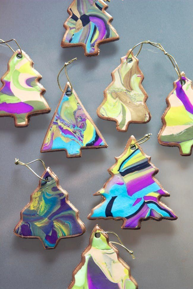 Jazz up your holiday decor with these DIY marbled Christmas tree ornaments.