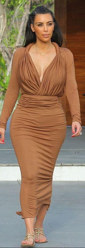 Who made Kim Kardashian's flat sandals and ruched brown maxi dress? Shirt and shirt – Givenchy Shoes – Gucci