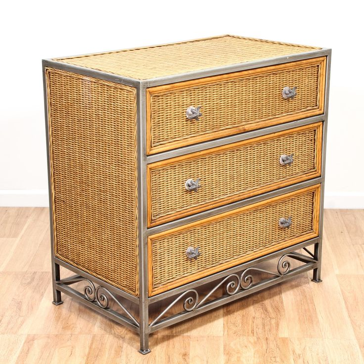 This coastal chest of drawers is featured in a woven wicker with a light wood finish. This small tropical dresser is in good condition with 3 large drawers, a brushed nickel metal frame and starfish knobs. Beach chic storage piece perfect for a small space! #coastal #dressers #shortdresser #sandiegovintage #vintagefurniture