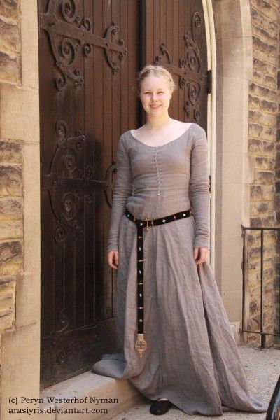 "grey kirtle with leather belt. Similar style dress for New Eden Township.  The dress is linen kept in its natural state. Image for vision board, ""Legacy"" by Jesikah Sundin."