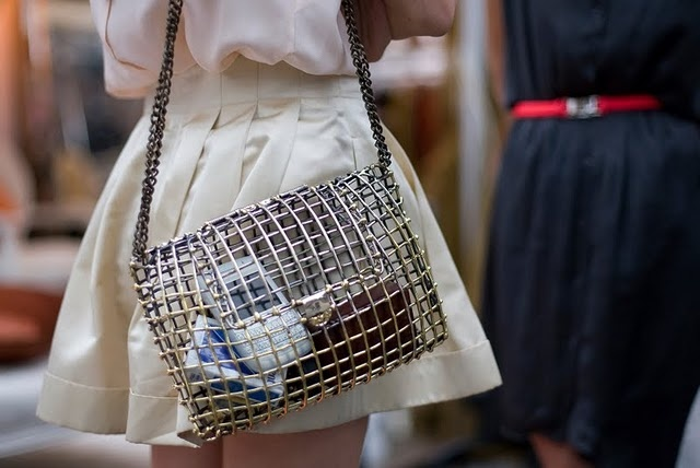 I like this purse for some reason,  not a diy,  but I could see using some hardware and lining it in clear vinyl.