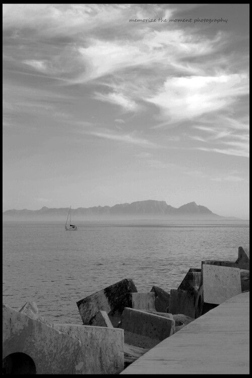 Table mountain , view, gordons bay harbour, sailing boat, , black and white, dollas, harbour wall.