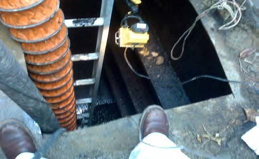 Ventilation hoses provide air and exhaust toxic vapors during confined space entry. A guardrail would also be necessary to protect workers from potential falls.