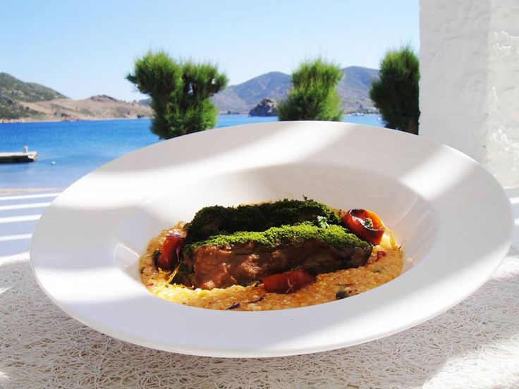 Lamb roasted in low temperature Crust from herbs / trachanas in tomatoe sauce