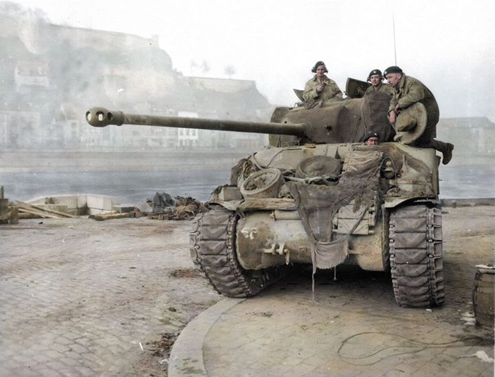 Lieutenant Robert Boscawen on the left with radiophones, commander of 2 Troop, 1st Battalion, Coldstream Guards, Guards Armoured Division, XXX Corps, in a Sherman Firefly IC Hybrid with a 17-pounder anti-tank gun as it's main armament, Patrolling the river Muese at Namur in Belgium. Monday, December 25, 1944.