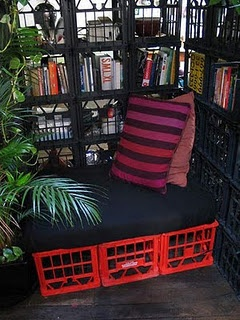 Great DIY way to make a cheap bench to tuck into a corner of your balcony. If you don't like the exposed-milk-crate look, just throw a tablecloth, sheet, or other piece of fabric over them.