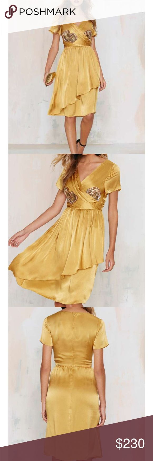 #43D Saunder Texas gold em dress 🐥🔵 The odds are in your favor. The Texas Gold 'Em dress comes in gold and features a plunging neckline, pleated wrap skirt, asymmetric hem, beaded floral appliqués at bust, and midi silhouette. Looks amazing with a floppy straw hat and wooden wedges. By Saunder.  *Silk  *Runs true to size  *Model is wearing size 2  *Dry clean only  *Imported Nasty Gal Dresses Mini